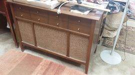 We have 3 old radio/vinyl album consoles for sell. These are antique and awesome looking for Mid Century Modern style.  All 3 work! Priced to sell.
