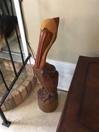 Wood carved pelican made by Charly Knight