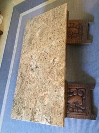 Cool granite top coffee table with Aztec carved feet