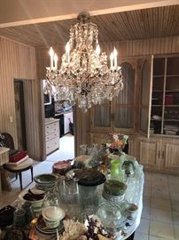 Chandelier and dining room table with 10 chairs