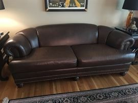 Excellent quality chocolate brown leather sofa with nailhead details, great condition except for some slight discoloration on the left cushion near the side of the armrest