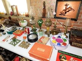 Many vintage oil lamps to choose from.