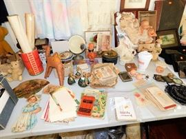 Lots of vintage paper, advertising , dolls and more.