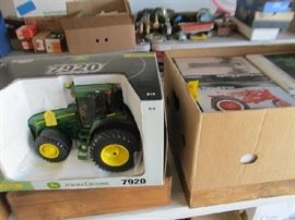 Large group of boxed farm toys.  All to be sold at 50% of marked price