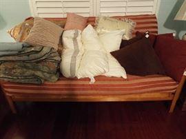 Nice futon full of linens