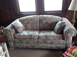 """Pullout sofa bed, measures 80"""" long."""
