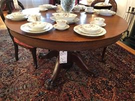 Early 1900's mahogany 4 foot round claw foot dining table