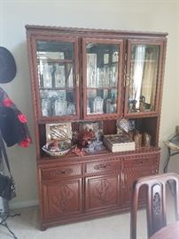 Carved wood Asian china cabinet