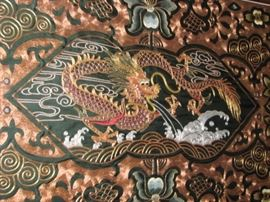 Intricate wall sculpture (copper strands) of a dragon