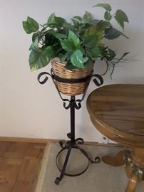 Wrought Iron Plant Stand with Woven Basket and Fake Ivy Plants.