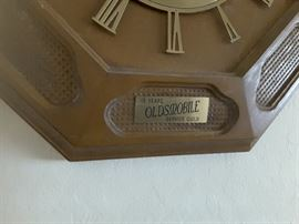 Close Up of Sign 15 Years Oldsmobile Service Guild on bottom of Elgin Wall Clock