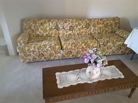 Vintage flowered yellow couch, 8 feet long, very comfortable, good for dormitory, college, romper room, setting up a new apartment, for basement, large workout and play rooms. Sturdy couch, in lovely condition.