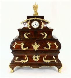 "French Regency Mahogany Three Drawer Mantle Cabinet Clock with ormolu (gilt bronze) trim and cherub top with clock insert. Clock face dial reads ""Burgess, Angers"""