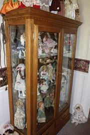 Display cabinet is lighted and large.  Perfect for this collection of dolls.  At least 30 of them, in variouls sizes.  But check out the cabinet.  It's newer and in good condition.
