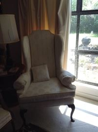 Pristine white wingback chair