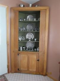 19th Century Pine corner cupboard. The lower section has room for storage while the upper section displays.  This cupboard has pewter from 1810-on