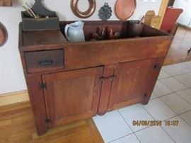 Pine dry sink is a 19th C piece with cast iron handles and hinges.