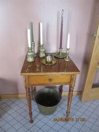 One of the one drawer stands in the home.  Under the table is a brass bucket from Meriden, Conn.