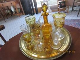 Some of the amber pieces in this home.  The early clear decanter in the back is 19th C.