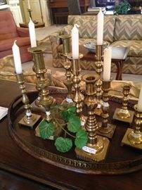 Great variety of brass candle holders