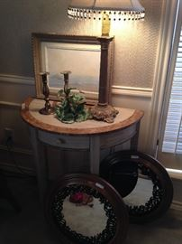 Demilune table; decorative lamp; small round mirrors