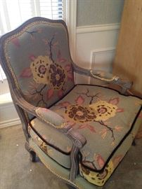 One of two beautifully upholstered arm chairs