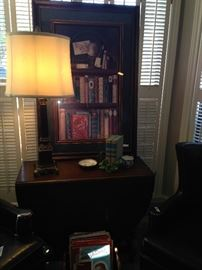 One of the many great lamps; drop leaf table; library books framed art.