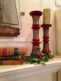 Old books and colorful candlesticks