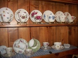 Cup and saucer collection in China cabinet