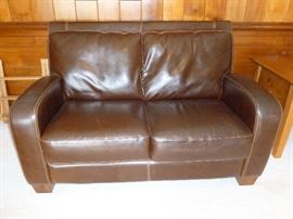 Leather? Loveseat..like new