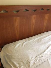 Head board of queen bed. Clean contemporary