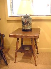 Antique oak parlor table with 1 of 2 matching lamps.
