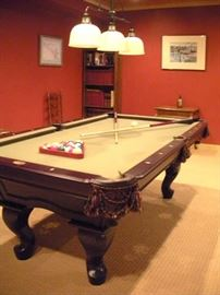 Canon slate top billiard pool table and accessories.