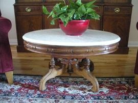 Antique walnut and marble top table.