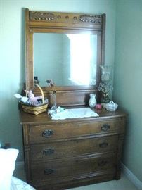 Antique Victorian oak dresser and mirror.