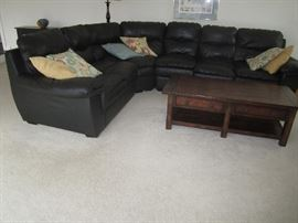 Black sectional sofa, coffee table