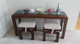 Sofa table with extra seating