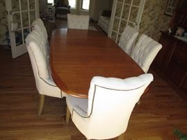 Teak dining table and upholstered chairs