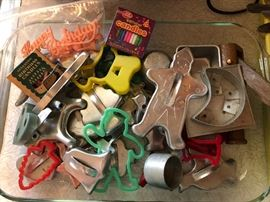 Pyrex Large baking pan filled with assorted cookie cutters