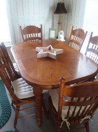 today $150,  table+ 1 leave + 6 chairs+ 6 cushions