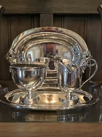 "Gonzalo Moreo Sterling Creamer and Covered Sugar with Tray in front of International Sterling ""Royal Danish"" Open Vegetable Dish"