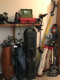 Golf clubs, trolling motor, router, bench grinder.