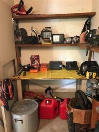 Old arbor press, Dremel, 60 qt Toroware boiling pot, chainsaw, shop vac, battery charger, jumper cables, workshop lighting, more!