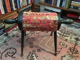Cylindrical foot stool that has original applied grass green stain with needlepoint tapestry .