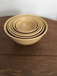 Nested set of six yellowware bowls.