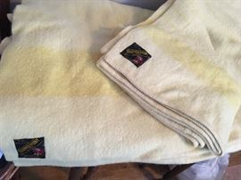 Trapper Point blankets in butter yellow; four points.