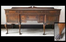 Antique sideboard buffet hand carved with paw feet