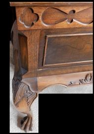 Close up of hand carved paw foot buffet