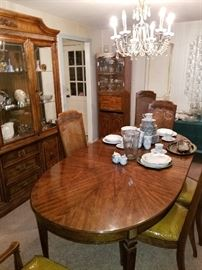 Solid dining room set with extra leafs and pads... glass chandler is also for sale