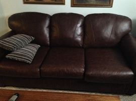 2 identical leather sofas